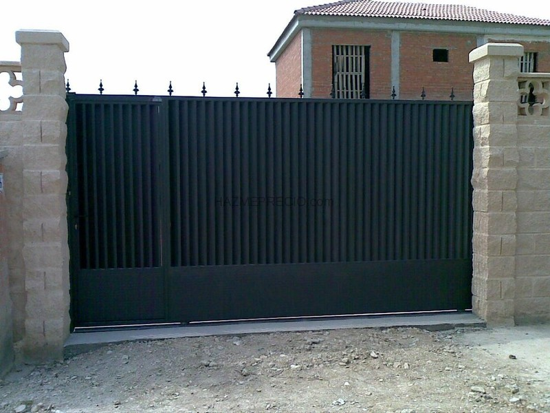 Cerrajeria madrid fabricaci n puertas 918862209 financiaci n for Precio puertas correderas de exterior